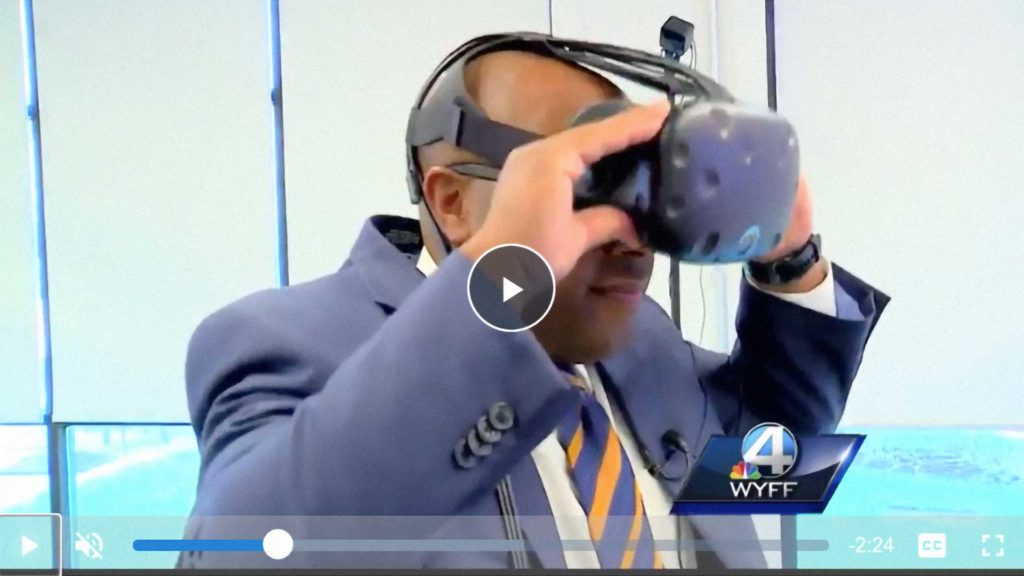 pictured: WYFF 4 News, Nigel Robertson takes a VR tour of the new WYFF office