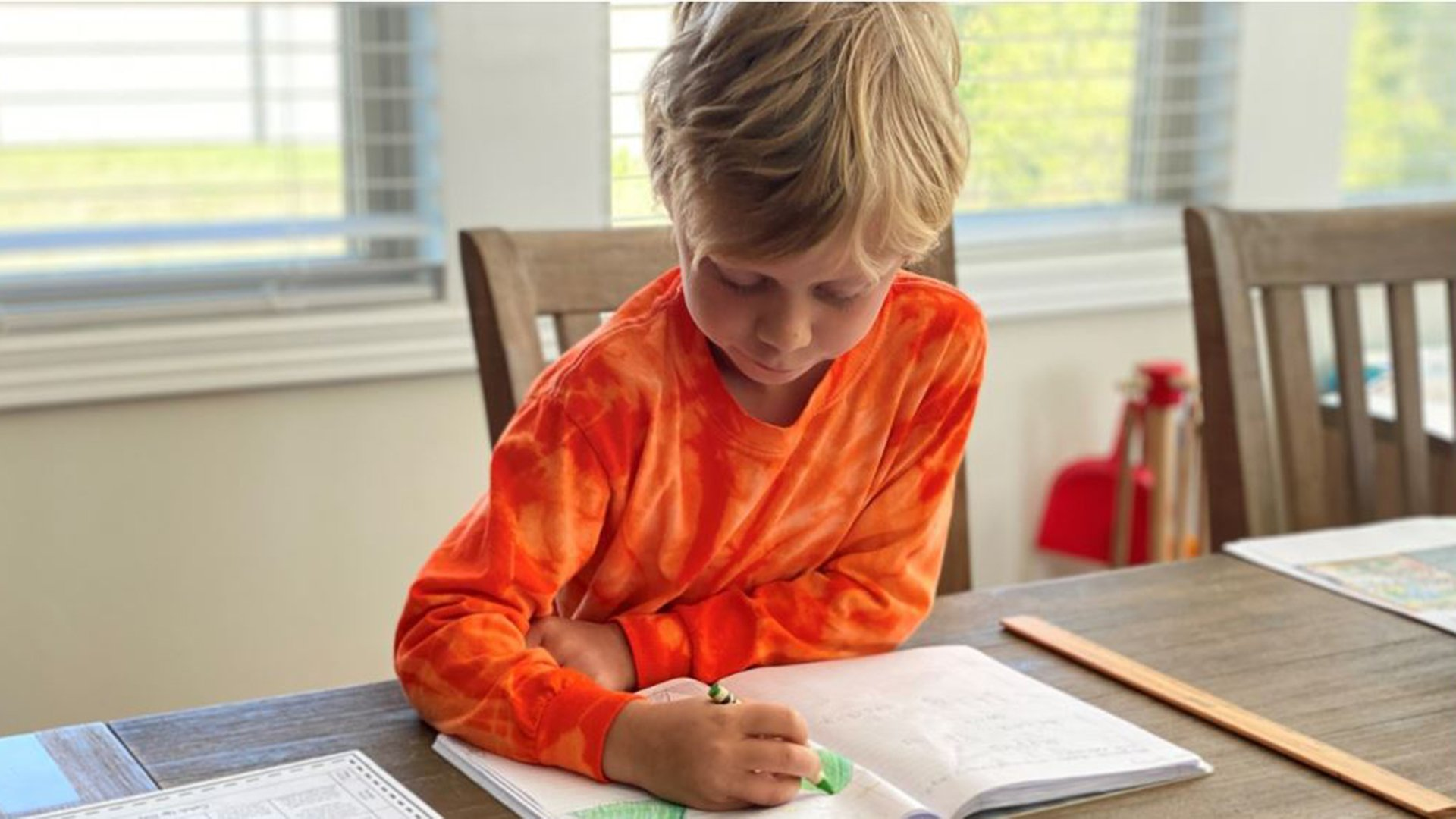 Photo of child doing schoolwork at home