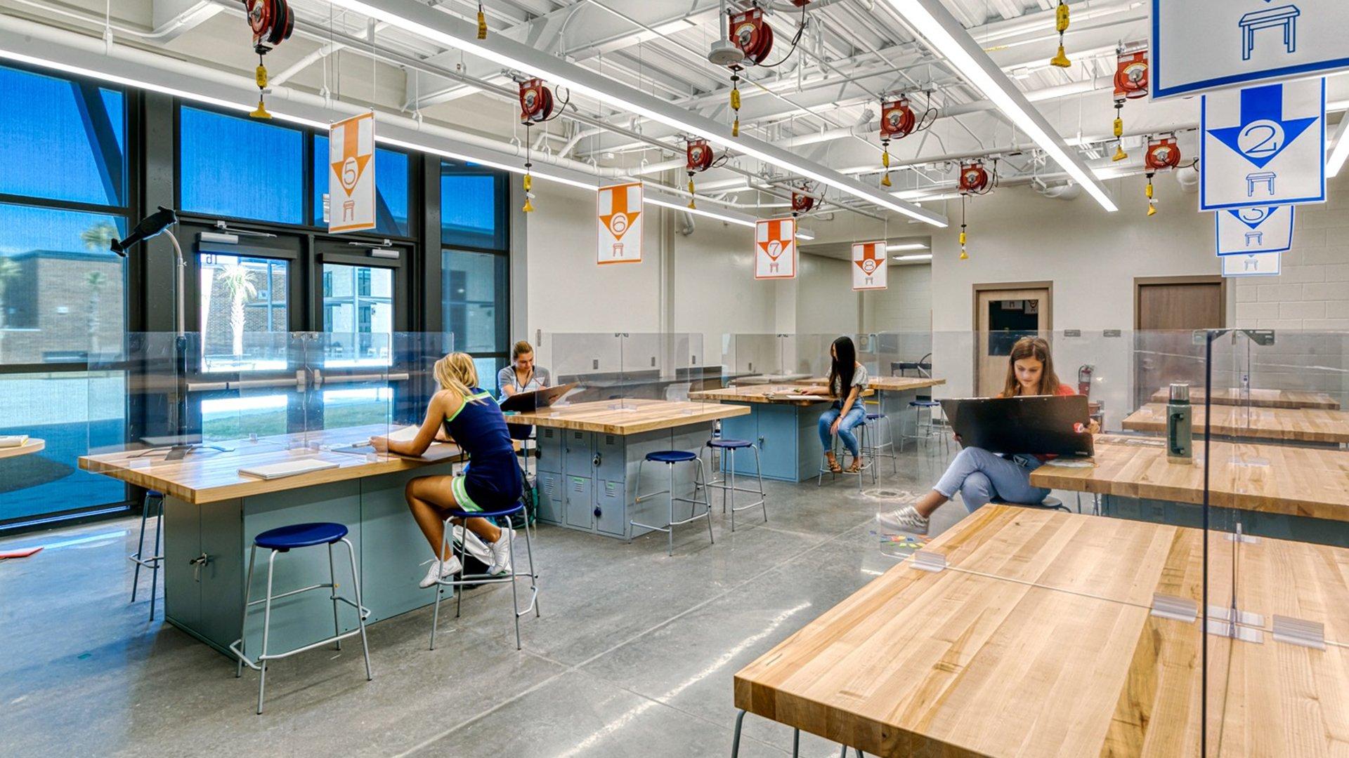 Lucy Garrett Beckham High School with COVID-19 plexi-glass barriers between desks.