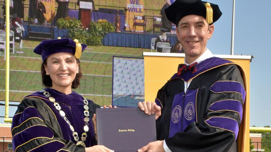 Pictured: Michael Chewning receiving his Doctor of Education degree