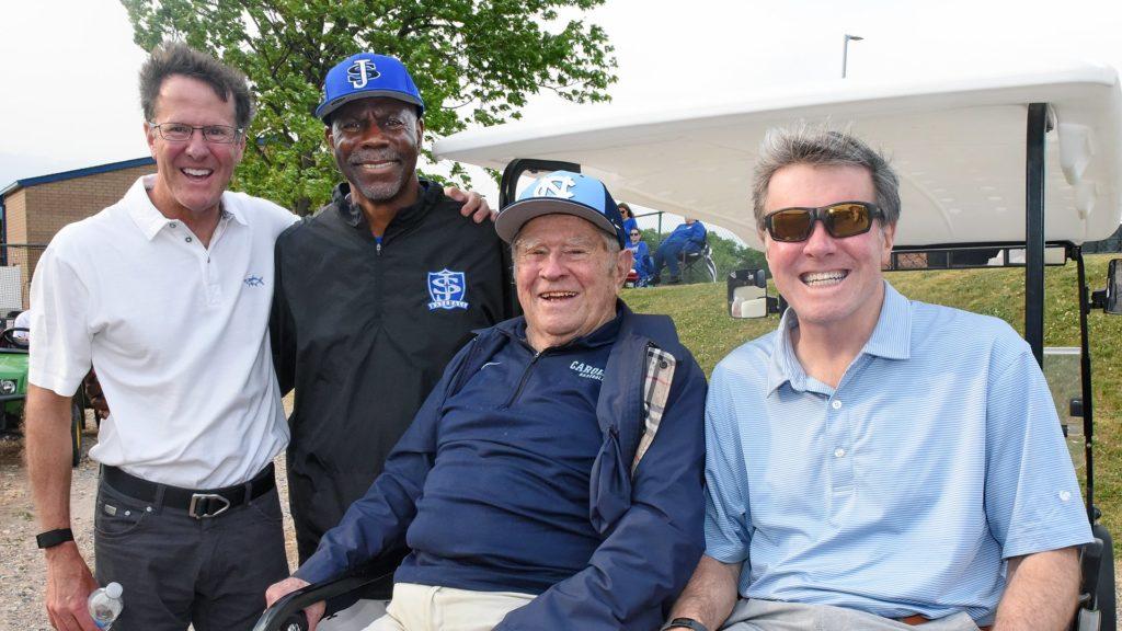Pictured, from right to left: Joe Pazdan, II and Joe Pazdan Sr., Head Coach George Turmon, and John Pazdan