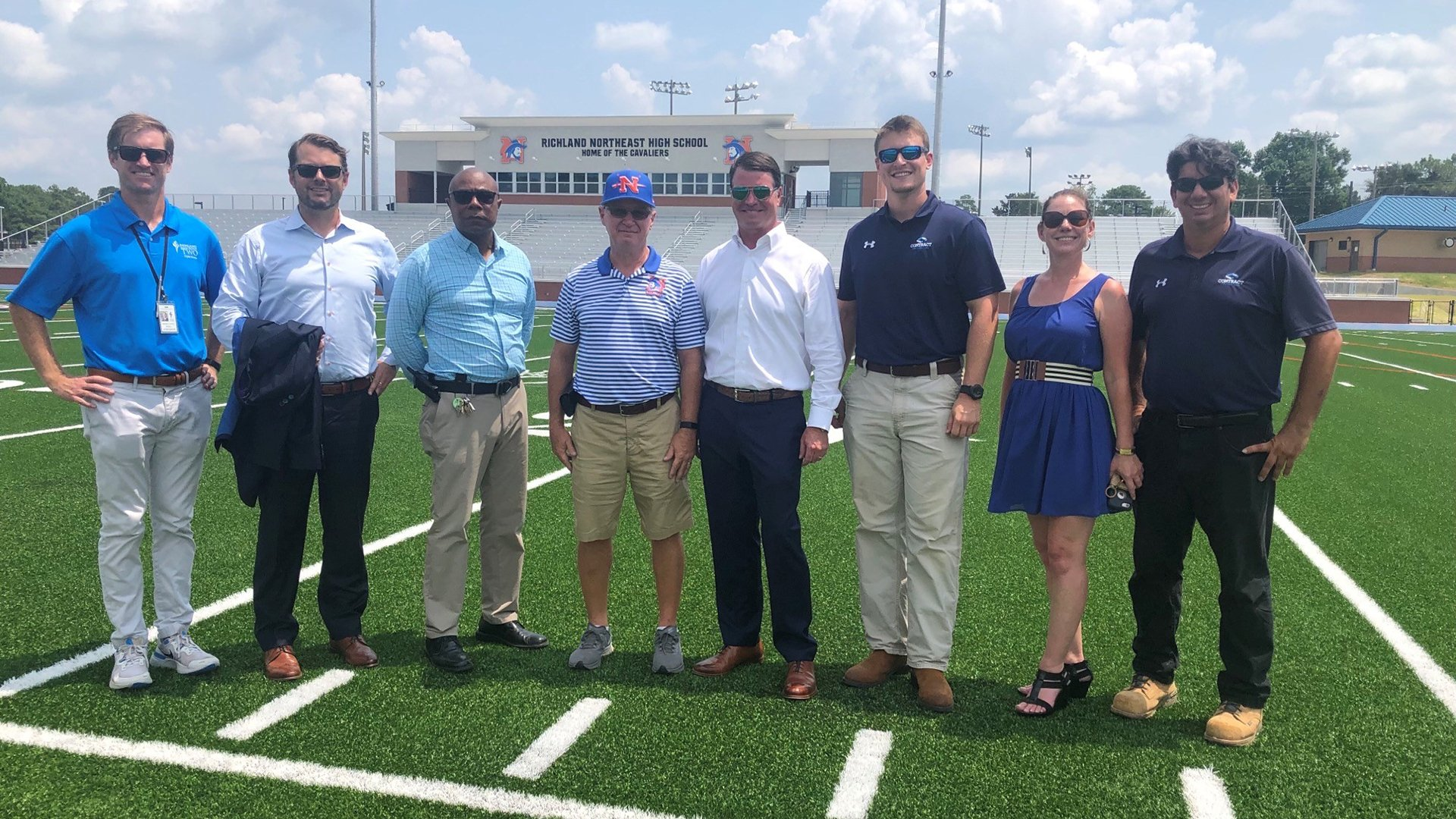 Pictured: 2nd from left, Ben Thompson at the Richland NE High School Stadium